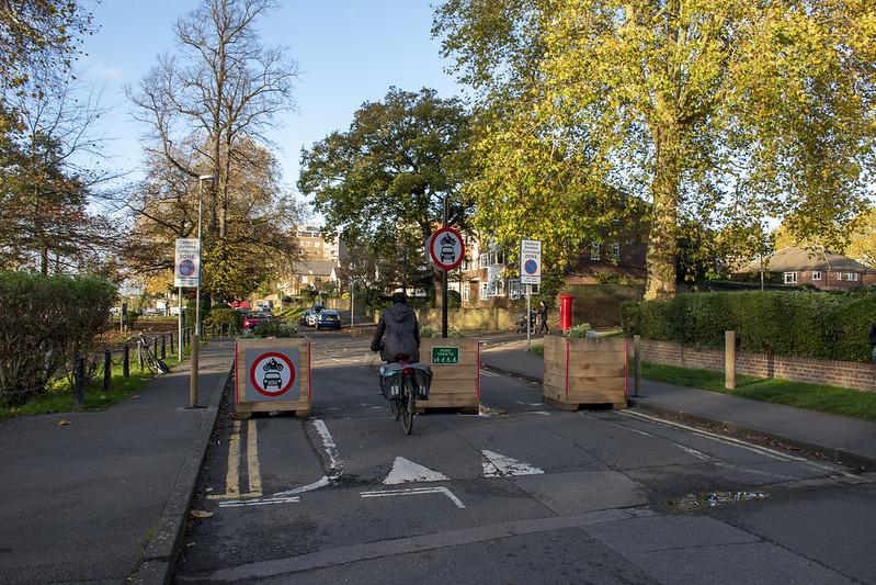 A cyclist going into a Low Traffic Neighbourhood using a modal filter
